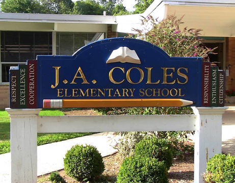 Top story 0c9b7ee635cd34c04441 coles school sign
