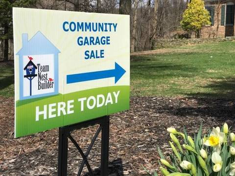 Top story 377a7b1335cd65134404 community garage sale lawn sign in front lawn  2
