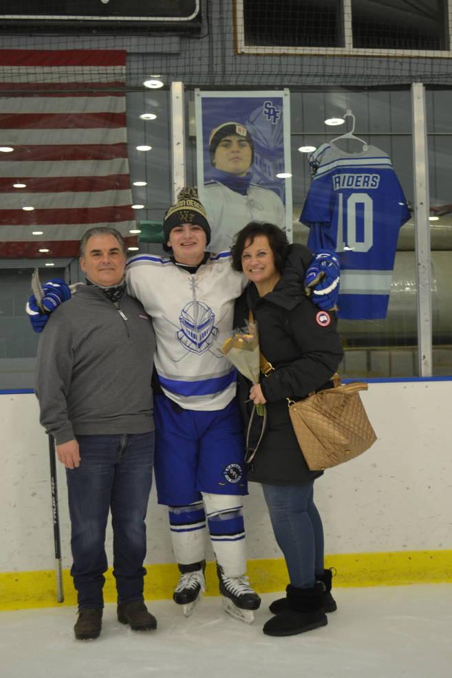 #10, Vincent Cucci with his parents at Scotch Plains-Fanwood hockey Senior Night.