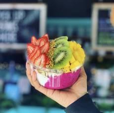Carousel image bd7d64d142de9ac27cd4 custom bowl  1 2 pitaya and 1 2 coconut with kiwi  mango   strawberries