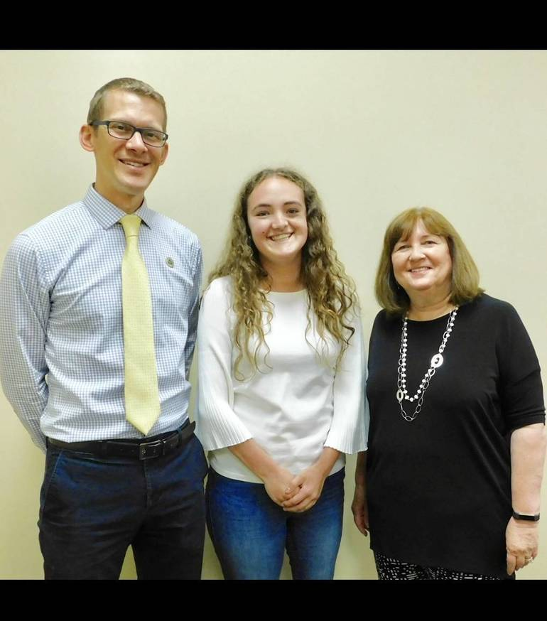 Senior Elisabeth Morris, center, is congratulated by WHREA (Watchung Hills Regional Educational Association) President and WHRHS Social Studies Teacher Ken Karnas, left, and Patricia Buzby, right, one of the two staff members in the Child Development Program at WHRHSD4666958-30B5-4354-ABD5-19783B87B5E8.jpeg