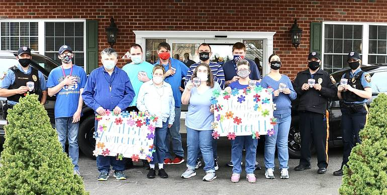 Warren Police Accept Donation from Mt. Bethel Village for Autism Awareness Fundraiser
