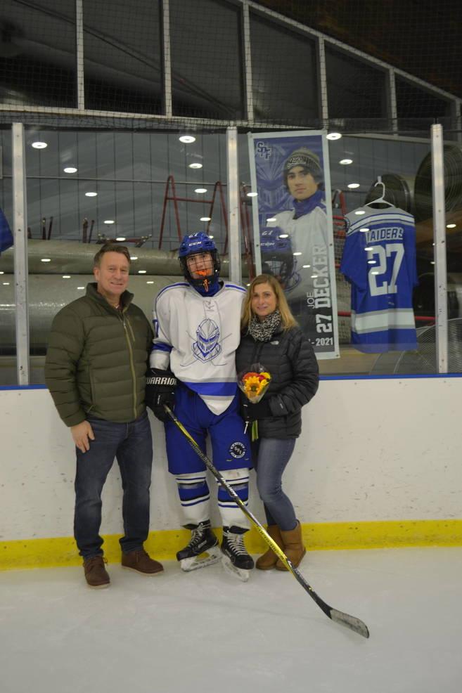 #27, Joe Decker with his parents at Scotch Plains-Fanwood hockey Senior Night.