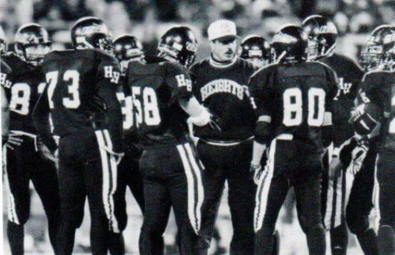 Defense huddled around coach Jeff Kresch 1994.JPG