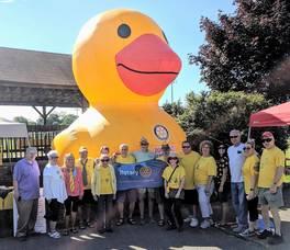 Carousel image 416a9087e4bd728a75de denville duck race 2019.rotary members 01