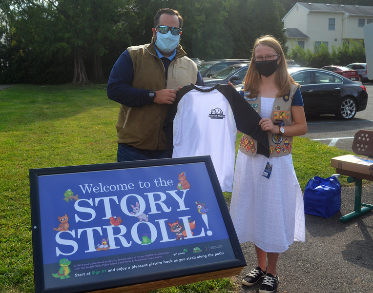 Union Catholic's Isabela Allen celebrates the opening of her ''Story Stroll'' at Jerseyland Park in Scotch Plains.