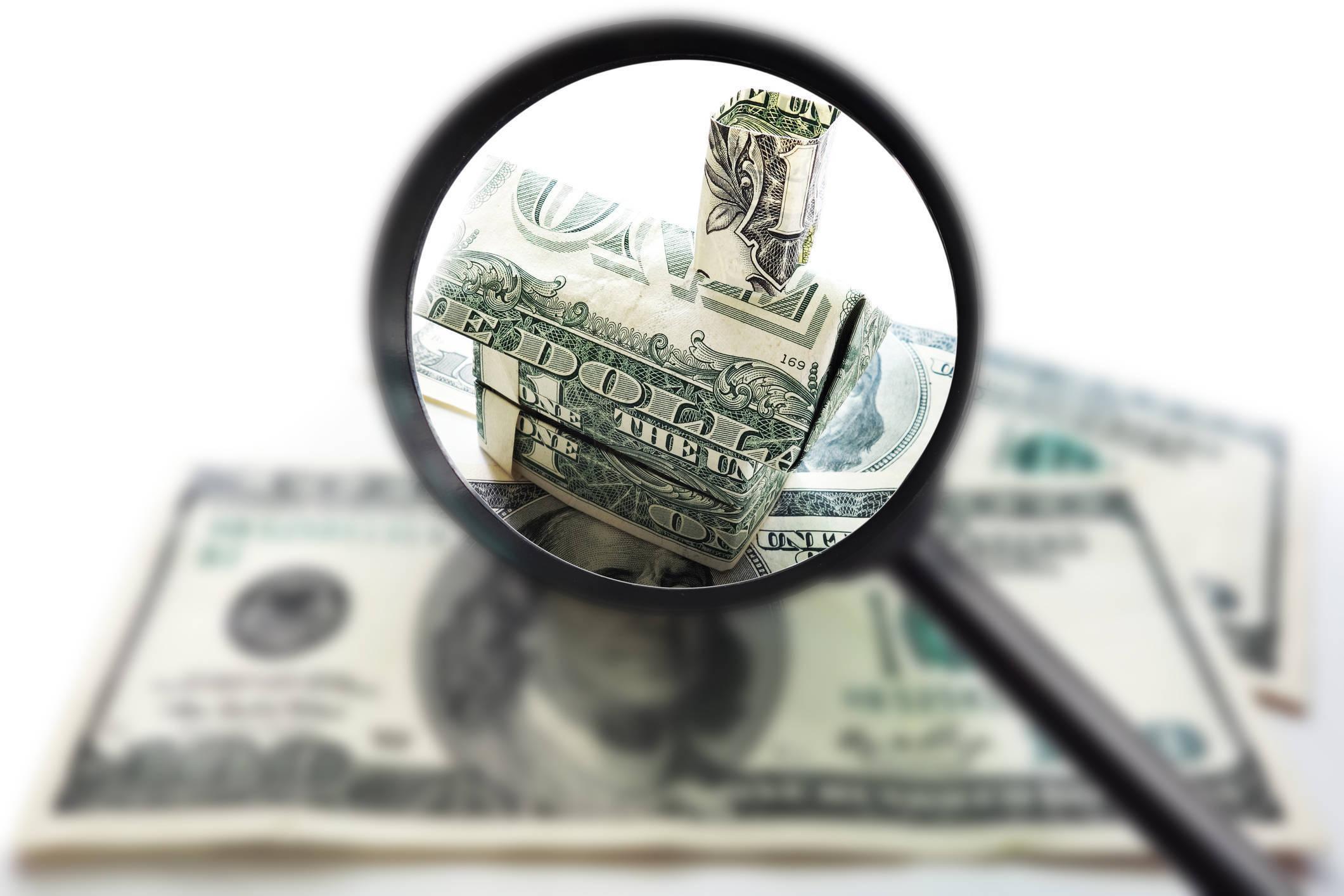 dollar bill home under magnifying glass affordable home myth.jpg