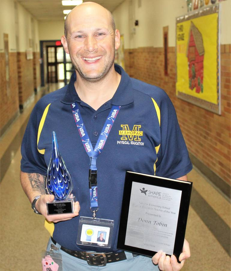 Donn Tobin with his district and national awards.jpg