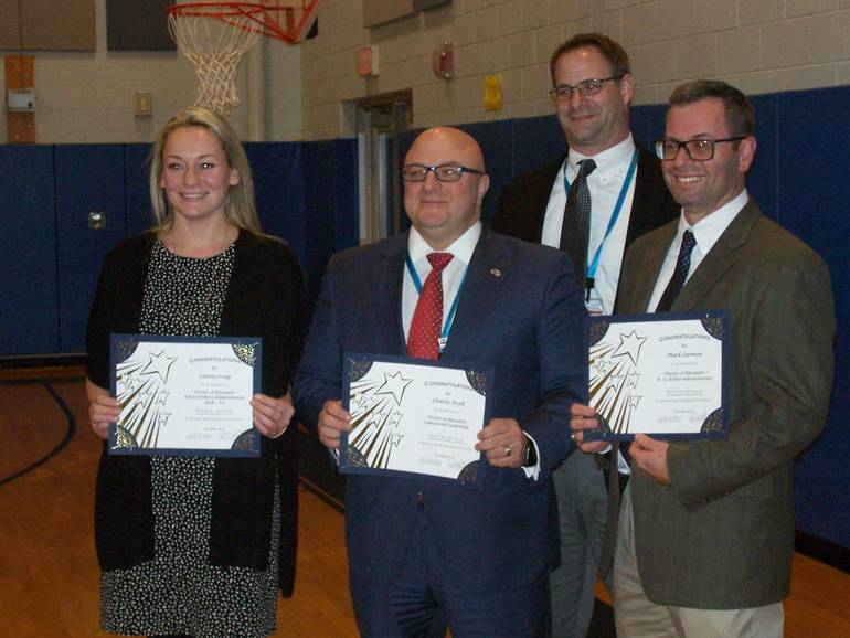 Laura Craig, Charles Ezell and Mark Jarmon, with Superintendent Russell Lazovick