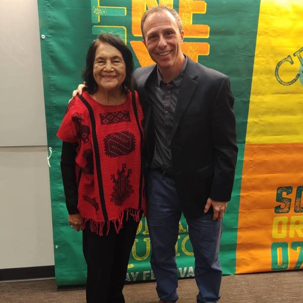 Dolores Huerta and SAS in front of Step and Repeat.jpg