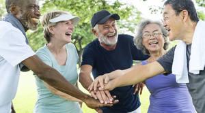 Multi-ethnic group of seniors laughing.