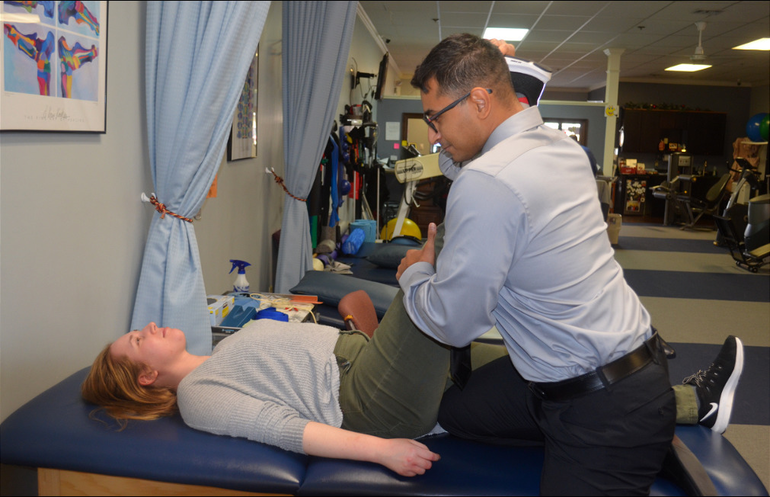 Dr. Omar Amer of Joint Motion Physical Therapy works with a patient.png