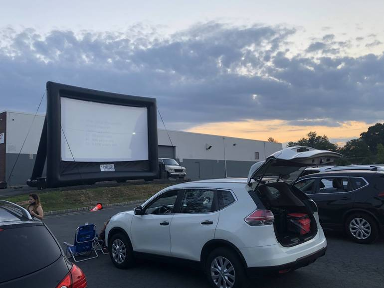 Drive-in screen with cars.jpg