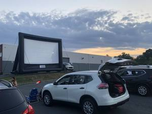 Carousel image ef932407991d0f354105 drive in screen with cars