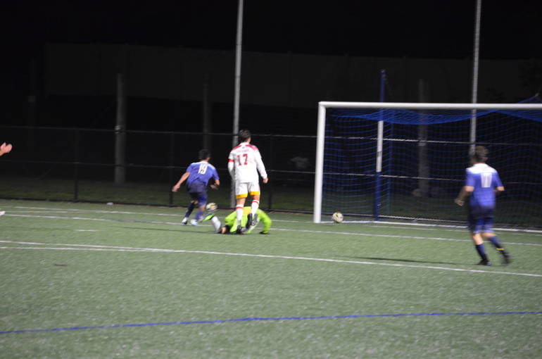 Dylan Fei scores the lone goal for the Raiders at Scotch Plains-Fanwood boys soccer's first game under the lights at Wexler Field.