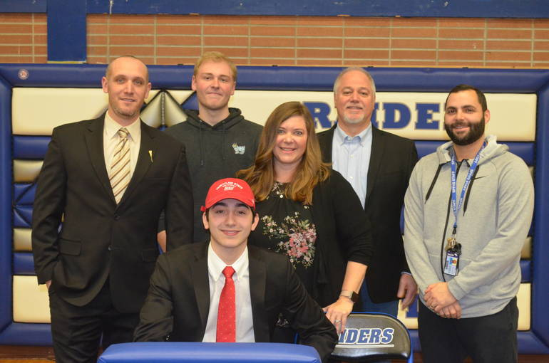 Scotch Plains-Fanwood lacrosse star Aiden Guma with his family and coaches.