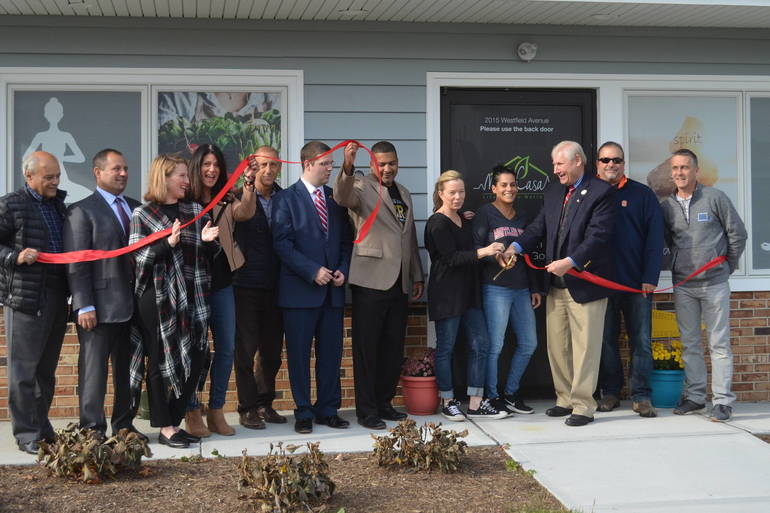 Mayor Al Smith, along with members of the Scotch Plains Council and the Greater Westfield Area Chamber of Commerce, helps cut the ribbon at Metta Casa in Scotch Plains opens.