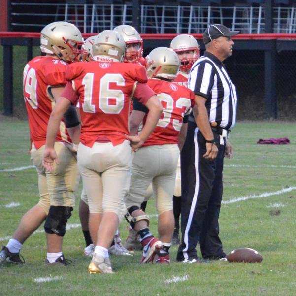 Olean football defense huddle