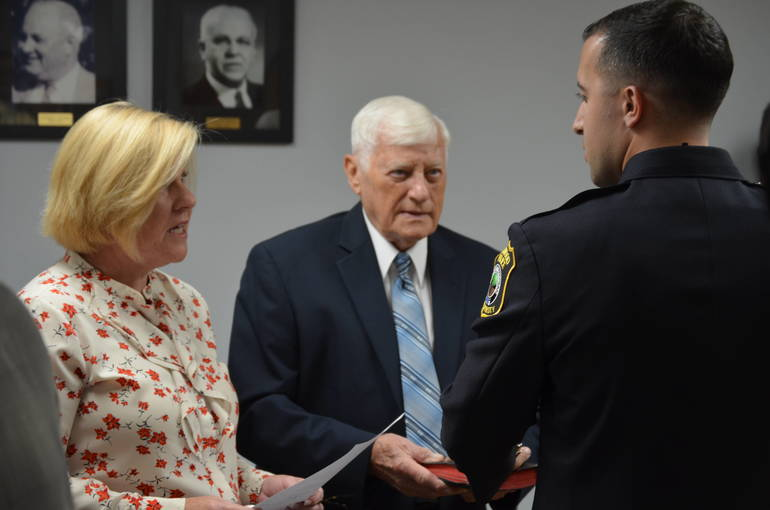 Fanwood Mayor Colleen Mahr swears in Officer Tyler Flowers, whose grandfather held The Bible.