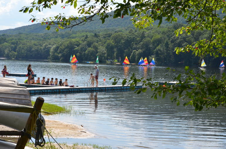 Campers enjoy swimming and boating on the lake.