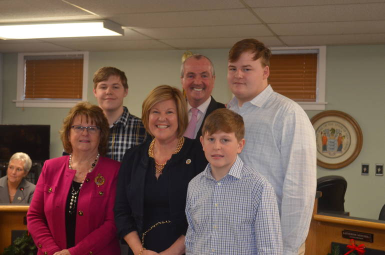 Fanwood Mayor Colleen Mahr with her sons and her mom with Gov. Phil Murphy on January 1, 2020, at Fanwood's Reorganization meeting.