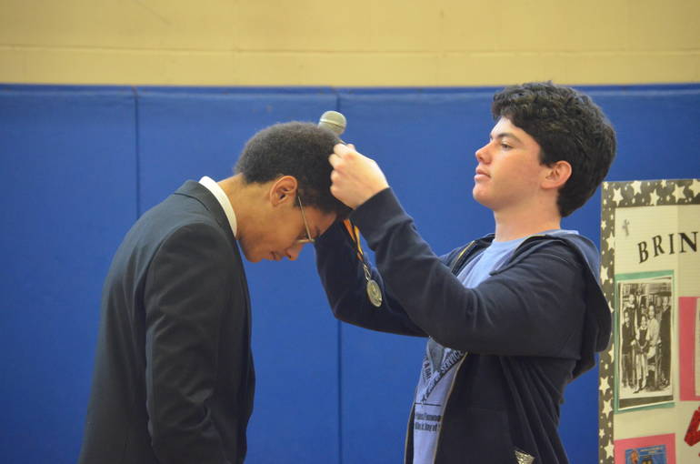 Anthony McDonald and Erzi Abraham reenact Dr. Martin Luther King's receiving the Nobel Peace Prize at MLK Day of Service in Scotch Plains-Fanwood.