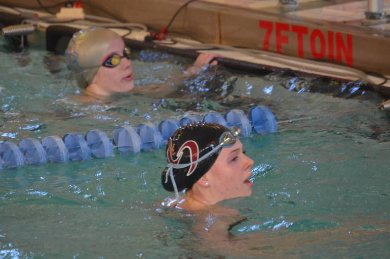 Dagny Donaldson of Summit (right) won the 200 Free.