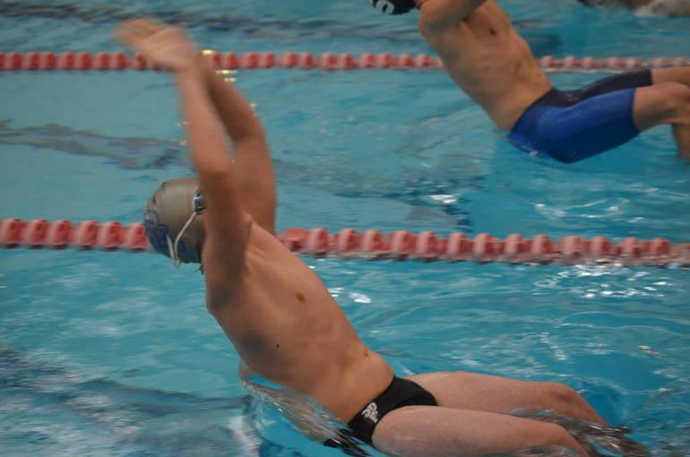 Scotch Plains-Fanwood swimmer Sean Stuart at the start of the 100 Backstroke.