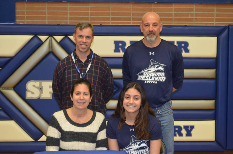 Scotch Plains-Fanwood soccer star Rachel Schoss with her parents and coach.