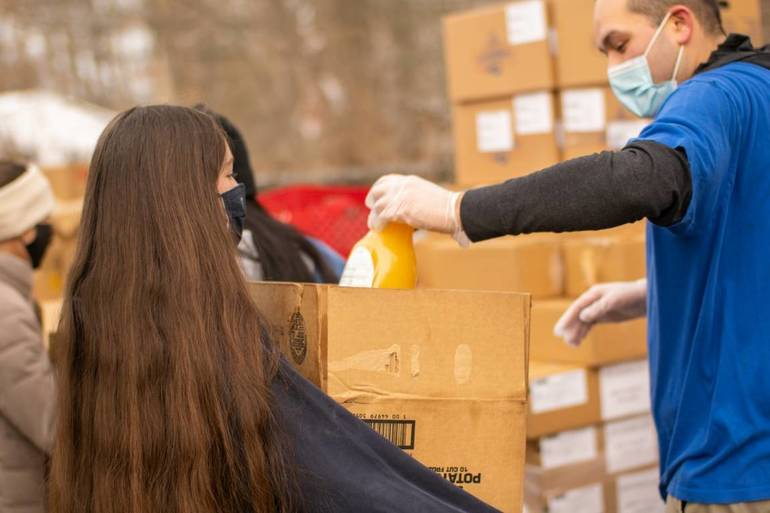 Kiwanis Club of Roxbury Joins in Distributing Food to Needy