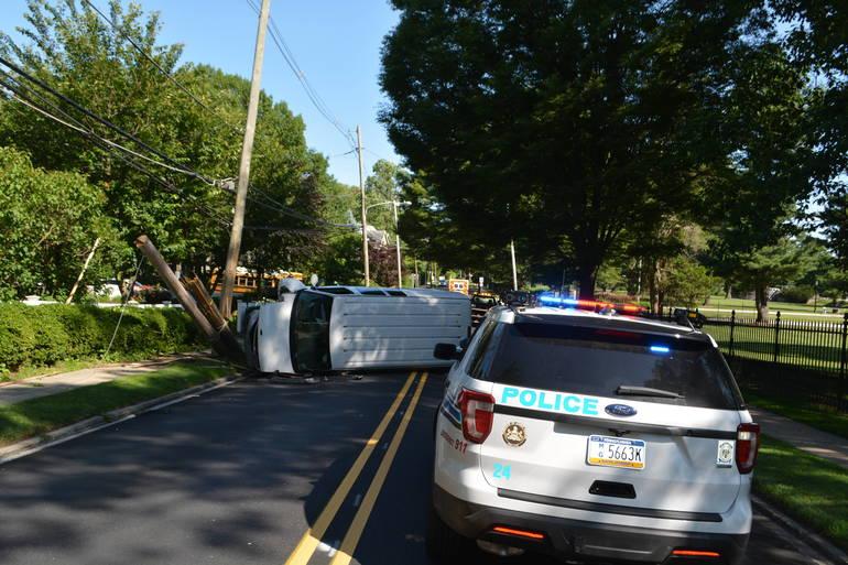 lower merion police at flipped van on wynnewood raod