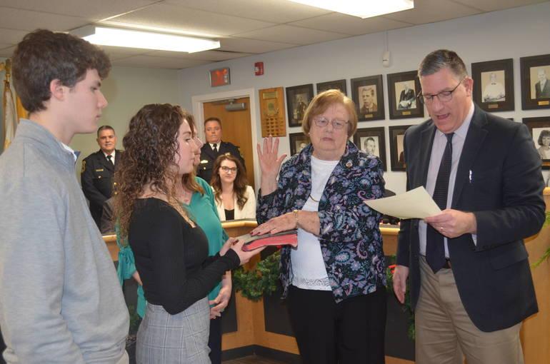 Russ Huegel swears in Fanwood Councilwoman Kathy Mitchell.