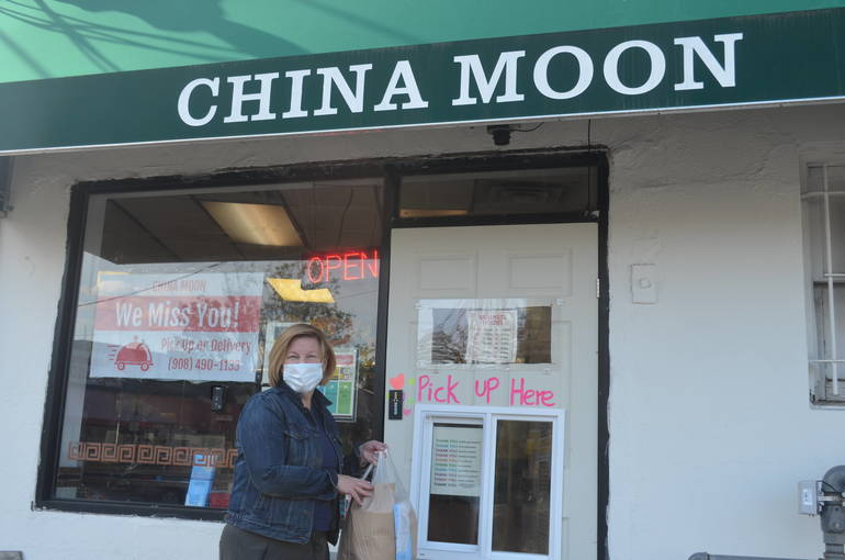Fanwood Mayor Colleen Mahr picks up an order from China Moon