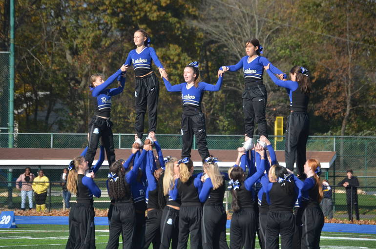 Scotch Plains-Fanwood cheerleaders perform at half time.