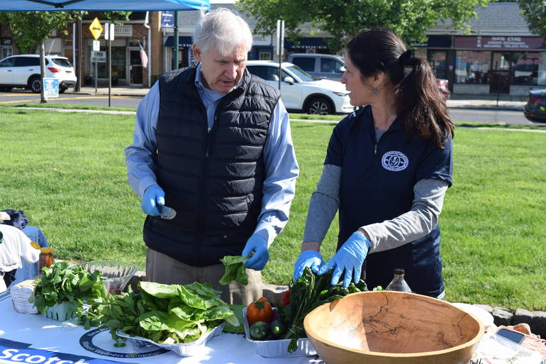 Scotch Plains Mayor Al Smith and Deputy Township Manager Margaret Heisey demonstrate the fine art of making a healthy salad.