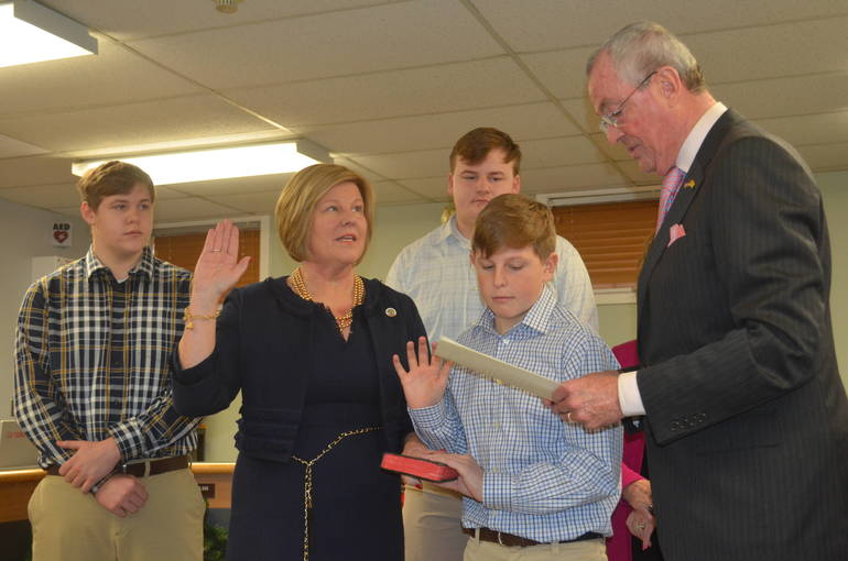 Gov. Phil Murphy swears in Fanwood Mayor Colleen Mahr, who is surrounded by her sons, (l to r), Daniel, Liam, and Colin.