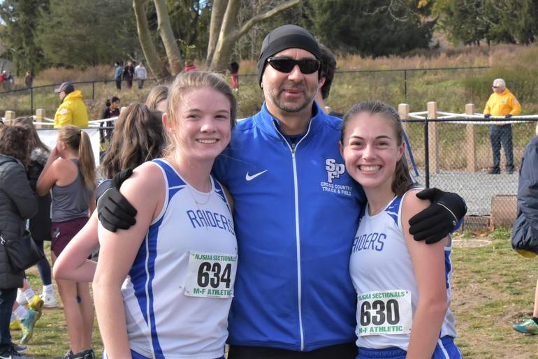 Olivia Zambrio and Gabby Crona with Scotch Plains-Fanwood X-Country Coach Jeff Koegel.