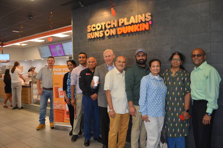 Scotch Plains Mayor Al Smith with the owners of the new Dunkin' Donuts franchise