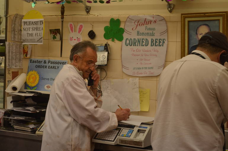 Vinnie Losavio takes an order over the phone at John's Meat Market in Scotch Plains.