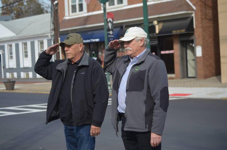 Vietnam vets Ralph Checchio and Bob LaCosta salute fallen comrades at Veterans Day services in Scotch Plains.