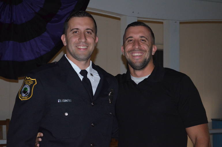 Fanwood police officer Tyler Flowers with his twin brother, Travis.