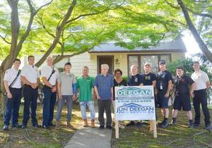 Members of the Scotch Plains fire department and employees of Deegan Roofing with John Mulligan