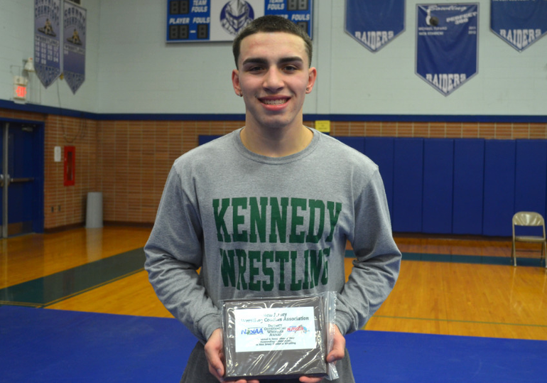 "Sergio Maglione of JFK High School, the 170 lb. winner, was voted the ""Wrestler of the Meet."""