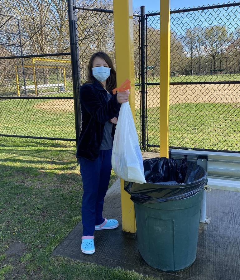 Phoebe Kaplan of Scotch Plains cleans up her school campus in honor of Earth Day.