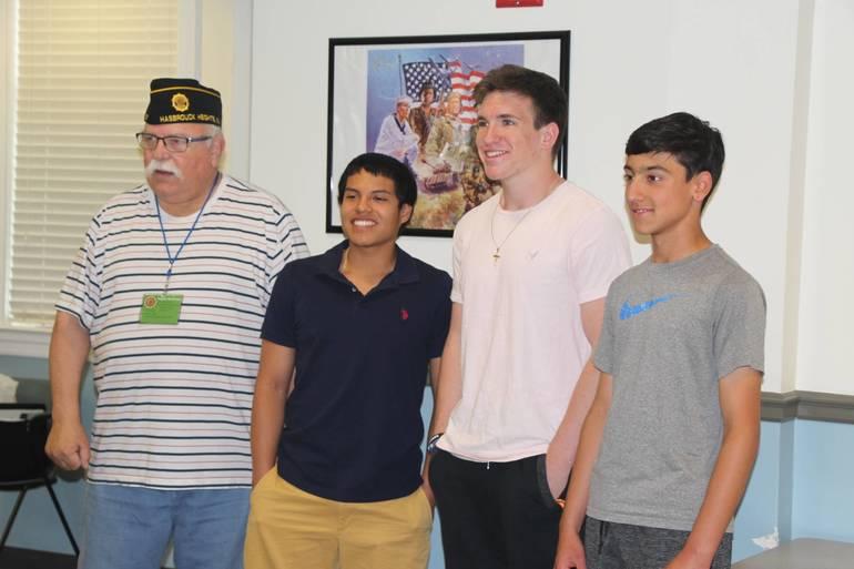 EDIT essay winners with Commander McCarthy.jpg