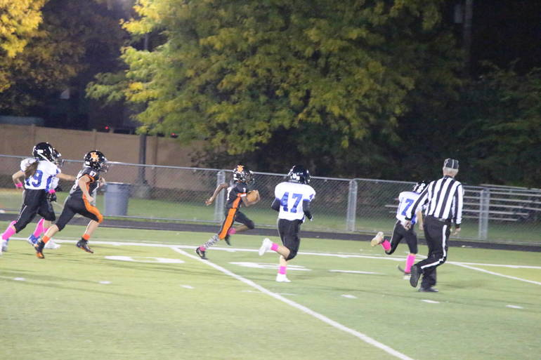 EDIT Juniors Jalil sideline TD run.jpg
