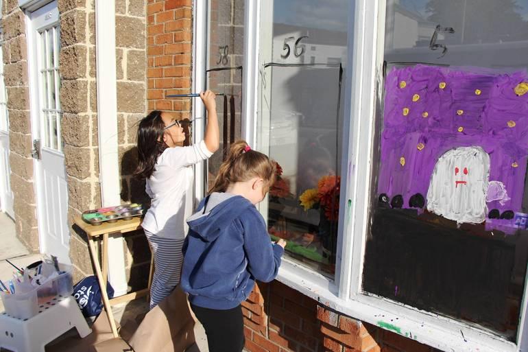 EDIT two girls paint window.jpg
