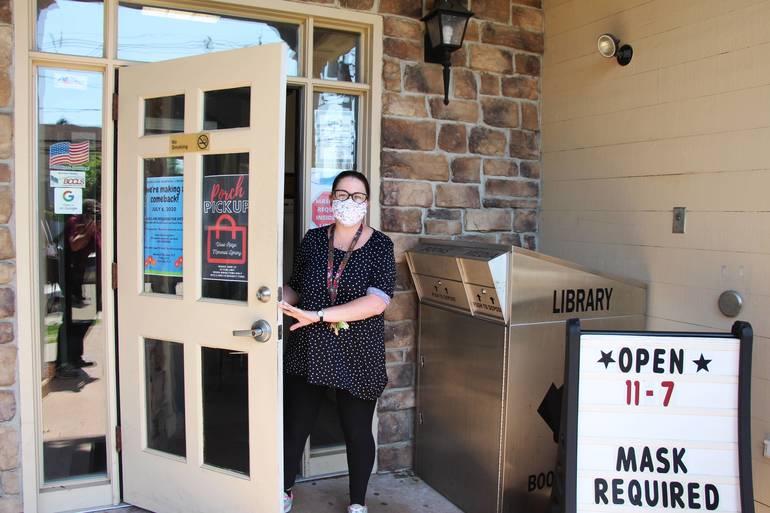 EDIT wr library dir Erin Hughes opens the doors.jpg