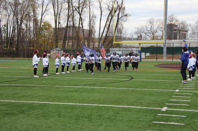 EDIT  team and cheerleaders pregame.jpg