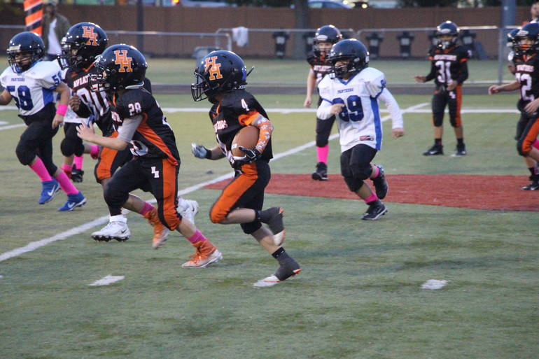 EDIT Raiders DeLorenzo runs Nick Haines Joshua Nelson block.jpg